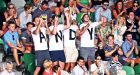 Tennis fans cheer during the second round match between Andy Murray and Sam Groth of Australia at the Australian Open. Photograph: EPA