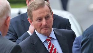 Taoiseach Enda Kenny said he would confirm the Government's commitment to keep the cost-base under control and contain public spending when he met existing and potential investors at Davos on Thursday. Photograph: Collins