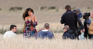 We Found Love: Rihanna making her video in a field owned by the DUP councillor Alan Graham; she took off more clothes than he was comfortable with. Photograph: Press Eye/Rex