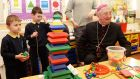 Catholic Archbishop of Dublin Diarmuid Martin with Karol Hawriluk and Sean Moore who are  Junior Infants pupils  at Our Lady of the Wayside National School in Bluebell, Dublin. Photograph: Eric Luke/The Irish Times.