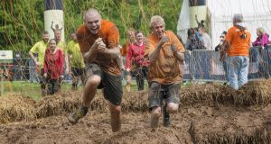 Competitors brave electric shocks during a Tough Mudder race