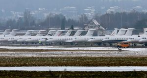 Passenger jets are parked at the Swiss Airforce base in Duebendorf, Switzerland, akin to a carpark for elite WEF participants  Photograph: Reuters