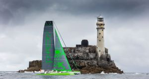 Record-breaking Phaedo passes Fastnet Rock lighthouse off west Cork last August. photograph: David Branigan/Oceansport.