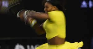 In this photograph taken with a slow shutter speed Serena Williams of the US plays a backhand return during her women's singles match against Russia's Daria Kasatkina. Photograph: Getty Images