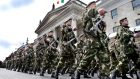 Defences Forces personnel march past the GPO in a previous  1916 commemoration. Former taoiseach John Bruton has criticised plans  to have Army personnel visiting schools as part of the 1916 centenary. File photograph: Matt Kavanagh/The Irish Times