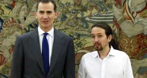 Spanish king Felipe VI (left)  with the leader of left-wing  party Podemos, Pablo Iglesia. Photograph: Angel Diaz /AFP/Getty Images