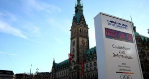 A clock in front of Hamburg town hall displays a countdown to the German city's referendum on whether to bid to host the Olympics – last November, the citizens voted against the bid. Photograph: Martin Rose/Bongarts/Getty Images