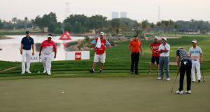 Jordan Spieth (L) finished his third round in Abu Dhabi playing in a six ball due to bad light. Photograph: Reuters
