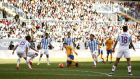 Lionel Messi's acrobatic goal gave Barcelona a 2-1 win away at Malaga. Photograph: Reuters