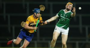 Limerick's Richie English and Bobby Duggan of Clare in action during the Munster Senior Hurling Championship Final at the  Gaelic Grounds in Limerick. Photograph:  Cathal Noonan/Inpho