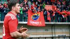 Ian Keatley applauds Munster's travelling support after his side's bonus point win against Treviso. Photograph: Inpho