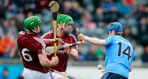 Dublin's Fionntan McGibb is challenged by Greg Lally and David Burke of Galway. Photograph: Inpho