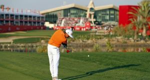Rickie Fowler  hits his second shot to the  18th hole during the final day of the  Abu Dhabi Golf Championship. Photograph: Ahmed Jadallah/Reuters