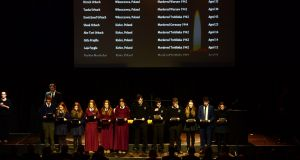 Students from Stratford College, Dublin; Laurel Hill Coláiste FCJ, Limerick; Coláiste Dhúlaigh, Dublin; and Newtown School, Waterford, read  out the Scroll of Names at the Holocaust Memorial Day. Photograph: Dara Mac Dónaill / The Irish Times