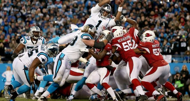 992e37e33d5a65 Cam Newton dives to score one of his two touchdowns in the Carolina  Panthers' win