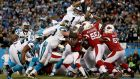 Cam Newton dives to score one of his two touchdowns in the Carolina Panthers' win over the Arizona Cardinals. Photograph: Getty