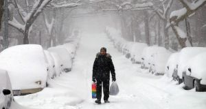 A man makes his way during a storm in New York on January 23rd, 2016. A blizzard hit the eastern US coast on January 23rd, paralyzing the capital and other cities under a heavy blanket of snow. Photograph: Jewel Samad/AFP/Getty Images