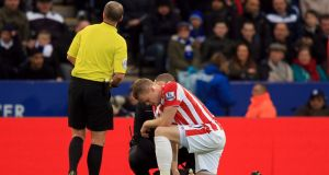 Stoke City's Ryan Shawcross receives treatment at the King Power Stadium, Leicester. Photograph: Mike Egerton/PA