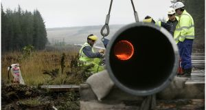Contractors dismantle an illegally installed section of the Corrib gas pipeline, at Aughoose, Co Mayo, in 2005. Photograph: Dara Mac Dónaill.