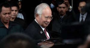 Malaysia's attorney-general cleared prime minister Najib Razak of any criminal offences or corruption on Tuesday, closing investigations into a murky multi-million-dollar funding scandal that his opponents had hoped would bring him down. Photograph: EPA/STR