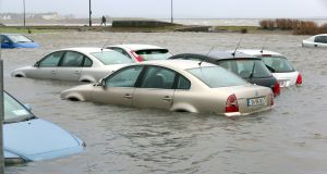 Cars in the flooded carpark beside Toft Park at Seapoint, Salthill in Co Galway on Tuesday morning. Photograph: Joe O'Shaughnessy