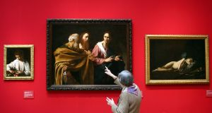 A visitor appraises Caravaggio's The Calling of Saints Peter and Andrew. Photograph: Getty Images