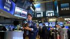 Wall Street rebounded sharply driven by a set of strong corporate results and recovering crude oil prices, ahead of the Federal Reserve's policy meeting and Apple's results.