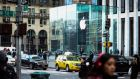 Traffic passes by the Apple store on 5th Avenue in New York. Photographer: Chris Goodney/Bloomberg