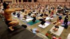 Bikram Choudhury leads a huge  yoga class in September 2003 at the Los Angeles Convention Centre. Photograph: Choudhury claims he is now nearly bankrupt. Photograph: Reed Saxon/AP