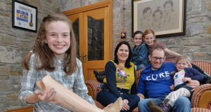 Amy Sheridan (11) who was born without a fibula, the long, thin bone in the lower leg that runs parallel to the tibia,  at home in Dunleer, Co Louth with her mother Caitríona, father Shay and sisters Sally (7), Lucy (9) and Kelly (4). Photograph: Alan Betson