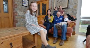 Amy Sheridan (11), who was born without a fibula, at home in Dunleer, Co Louth with her mother Caitríona, father Shay and sisters Sally (7), Lucy (9) and Kelly (4).  Photograph: Alan Betson