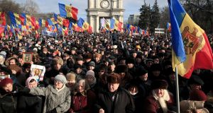 Protesters shout slogans during a large demonstration in Chisinau, Moldova, on Sunday. Photograph: Vadim Ghirda/EPA