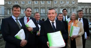 Chairman Ciaran Lynch  (c) and members of the Oireachtas banking inquiry at the publication of the inquiry's report at Leinster House, Dublin. Photograph: Brian Lawless/PA Wire