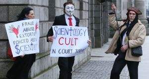 Anti-Church of Scientology protesters  stage a  demonstration outside the Four Courts in Dublin before an action involving a member of the church, Zabrina Collins. Photograph: Courts Collins