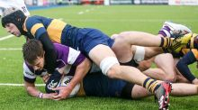 Clongowes' Miles O'Connor scores a try. Photograph: Gary Carr/Inpho