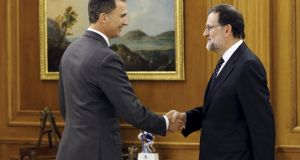 Spain's King Felipe (left) greets acting prime minister Mariano Rajoy before their meeting at Zarzuela Palace in Madrid. Photograph: Andres Ballesteros/Reuters