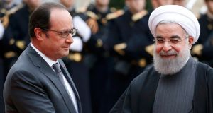 French president François Hollande  welcomes Iran's president Hassan Rouhani as he arrives at the Élysée Palace in Paris.  Photograph: Charles Platiau/Reuters