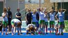 The Ireland players show their dejection after losing the penalty shoot-out to China in the World League quarter-final in Valencia. Photograph: Stanislas Brochier/Inpho