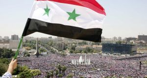 A Syrian protester waves a national flag at a rally  in June 2011.  Five years of this conflict have been too much, says UN envoy Staffan de Mistura. Photograph: AP Photo