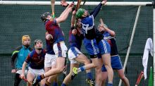 UL's Brian Stapleton and Gerard Hegarty compete with John Henderson and Jack Guiney of DIT  during the Fitzgibbon Cup first-round game at Parnells GAA Club in Dublin. Photograph: Dan Sheridan/Inpho
