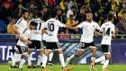 Valencia players celebrate after scoring against Las Palmas during the Copa del Rey quarter finals second leg. Photo: PA