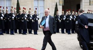 French Finance minister Michel Sapin arrives before a meeting with the Iranian president at the Elysee Palace. Photograph: Stephane de Sakutin/Getty Images