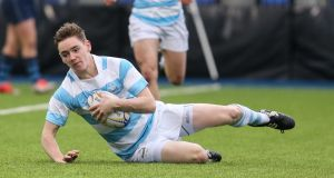 Blackrock's Conor Kelly scores a try against Castleknock. Photograph: Gary Carr/Inpho