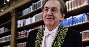 French philosopher Alain Finkielkraut poses in the Institut de France library prior to his induction ceremony at the Académie francaise on Thursday. Photograph: EPA/Christophe Petit Tesson