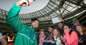 Scrumhalf Conor Murray takes a selfie with young supporters during Ireland's open training session at the Aviva Stadium. Photograph: Morgan Treacy/Inpho