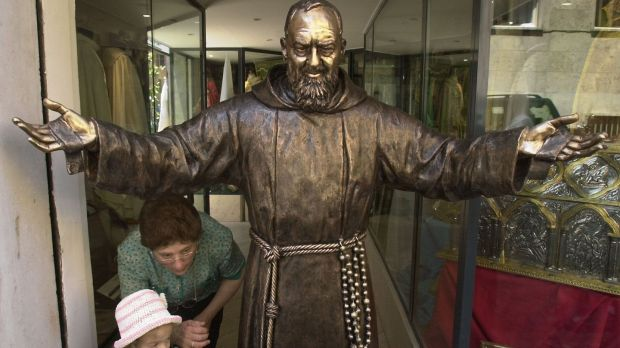 Statue of Padre Pio in Rome: saint's relics will go on tour at the request of Pope Francis. Photograph: Pier Paolo Cito/AP Photo