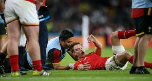 Wales winger Liam Williams receives treatment after sustaining a head injuring during the World Cup match against England. He sat out the next match against Fiji before returning for the final pool game against Australia. Photograph: INPHO/James Crombie