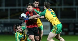 Down's Mark Poland is well surrounded by Donegal players during the Allianz National League Division One game in Newry. Photograph: Matt Mackey/Inpho/Presseye