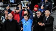 Dublin captain Liam Rushe lifts the Walsh Cup after the victory over Wexford at Croke Park. Photograph: Tommy Grealy/Inpho