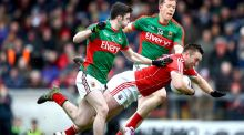 Mayo's Brendan Harrison and Donal Vaughan with Paul Kerrigan of Cork. Photograph: James Crombie/Inpho
